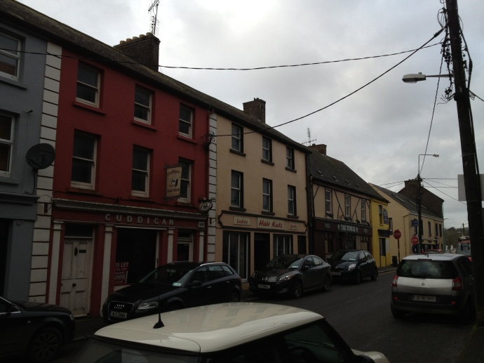 The RIC Barracks ('Hair Kutz', the yellow building) was flanked by two pubs, Meade's (the red building to the left) and Power's (to the right of 'Hair Kutz')
