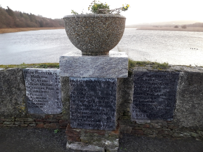 Milestones in place on the bridge at Rostellan, with Rostellan Lake in the background, and the main site of the former pleasure gardens at left (Damian Shiels)